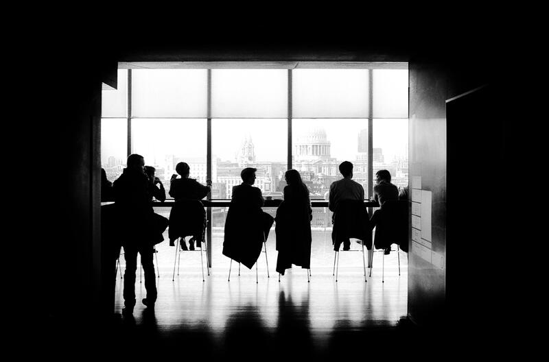 Business leaders in front of a window