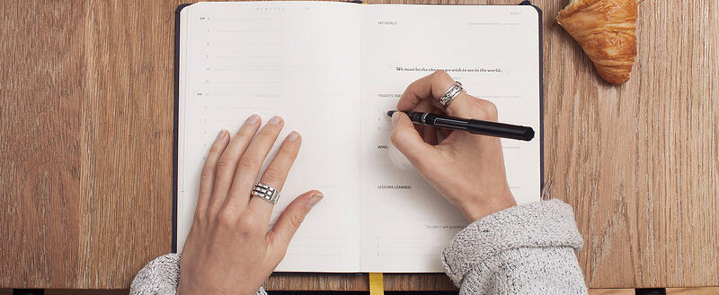 Woman's hands on an emotional intelligence notebook