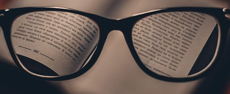 Glasses looking at a book